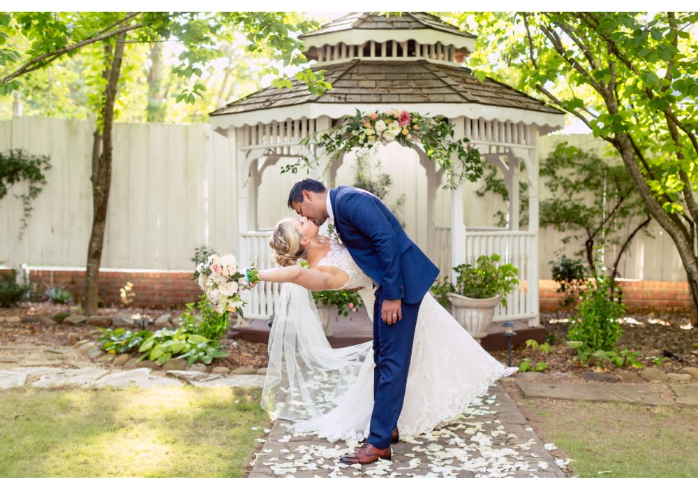 09-LillianGardens_Newlyweds-Dramatic-kiss-at-Gazebo-Newnan-GA